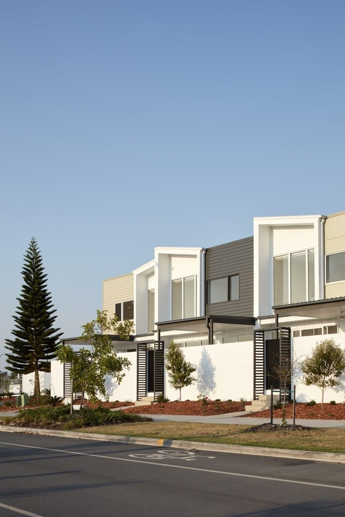 Modern row houses with Perfect Five Rib Commercial Roofing