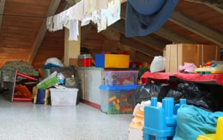 A miscellaneous selection of items stored in the roof cavity of a home.