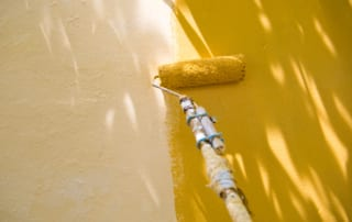 painting a wall with roller